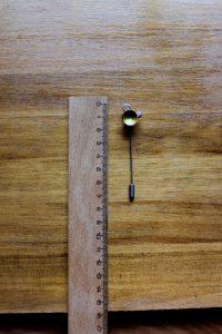 Alfiler realizado a mano y elaborada en cobre y aluminio